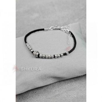 Женский кожаный браслет с металлическими бусинами черный